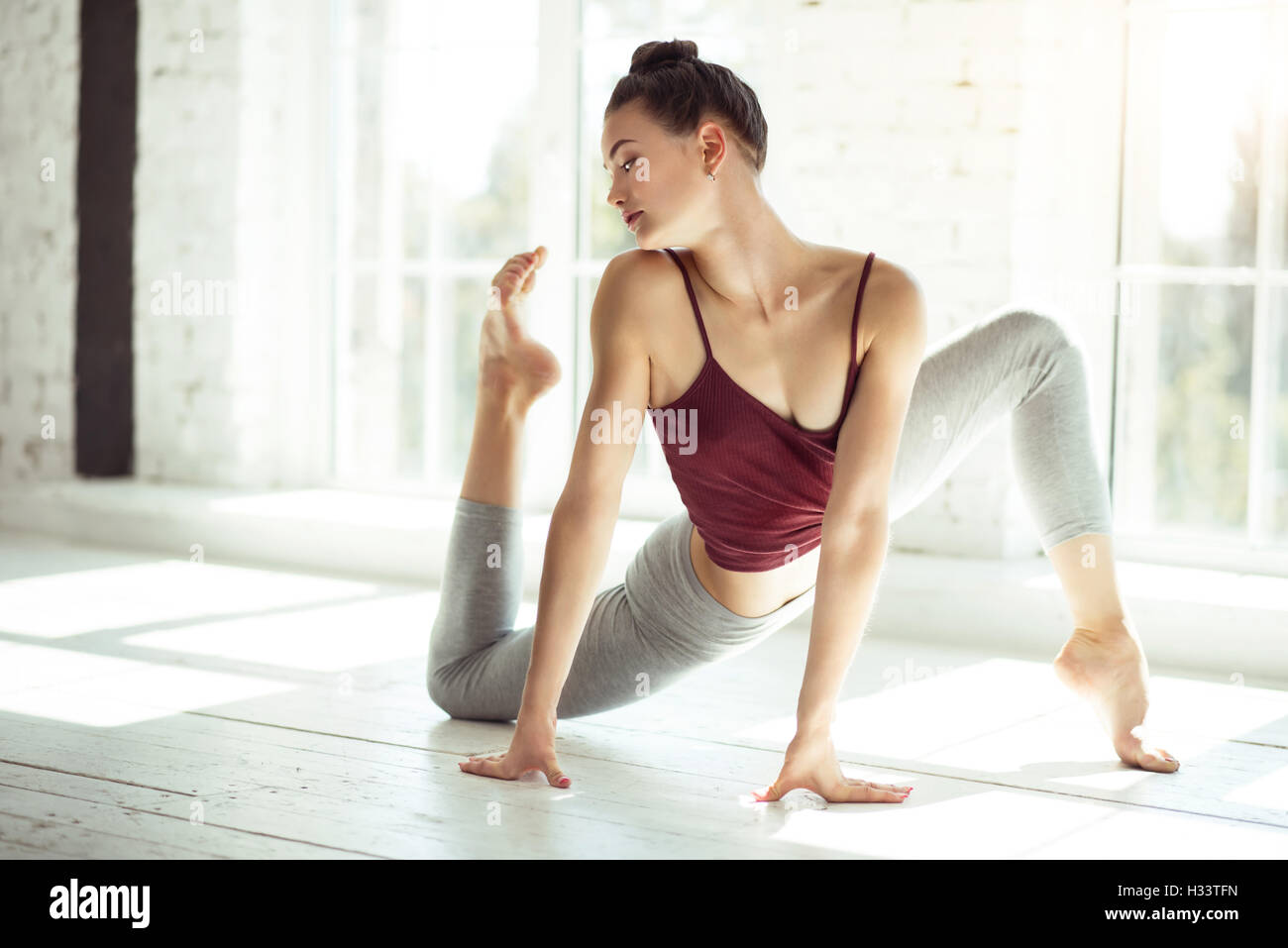 Professional talented dancer exercising in a dance hall - Stock Image