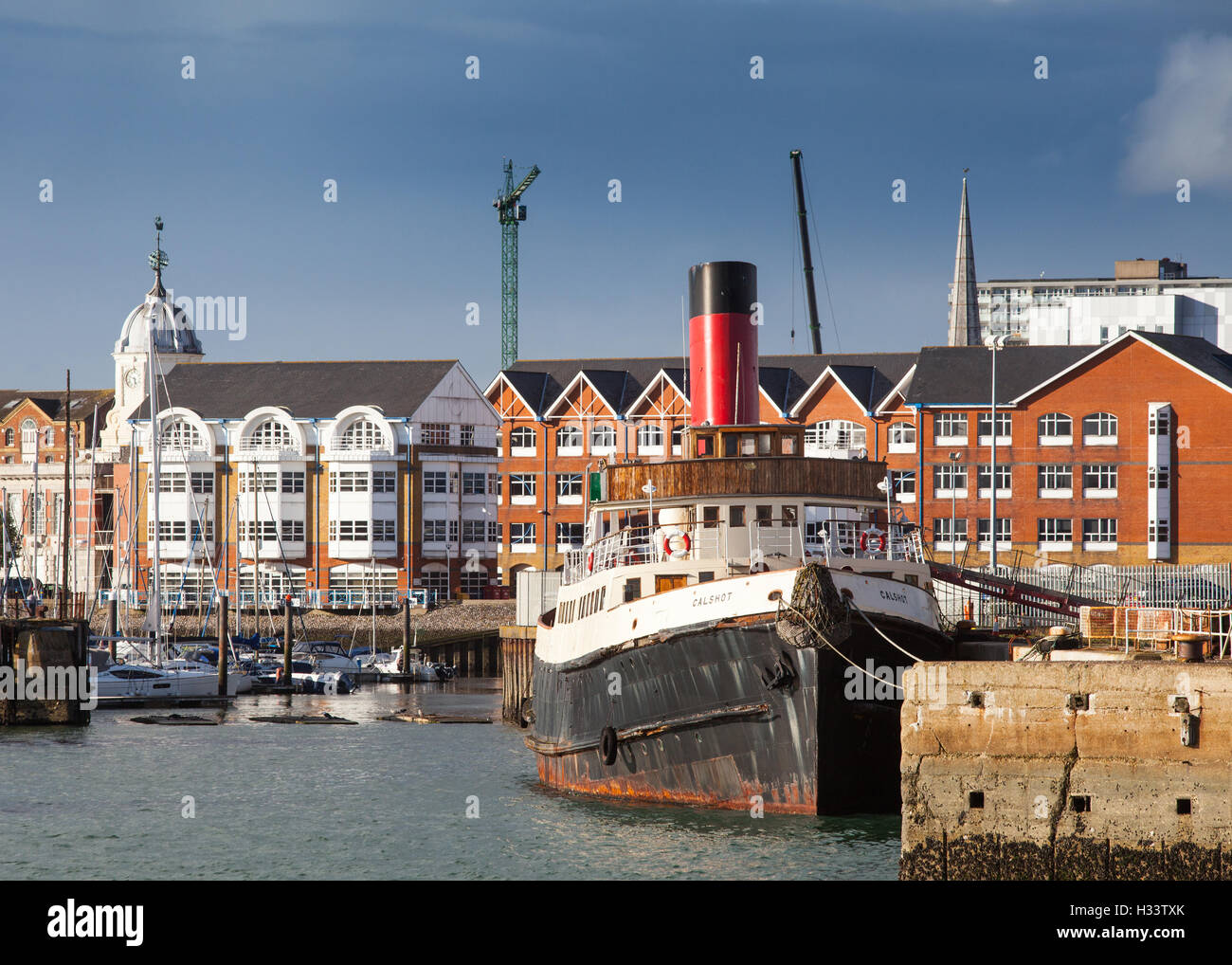 Southampton waterfront and Town Quay with historic tug boat Calshot in the foreground - Stock Image