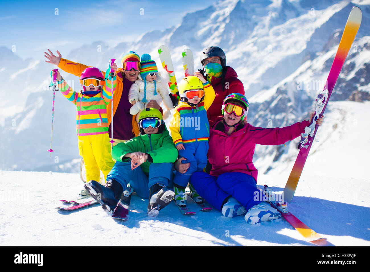 Family Ski Vacation Group Of Skiers In Swiss Alps Mountains Adults And Young Children Teenager Baby Skiing Winter