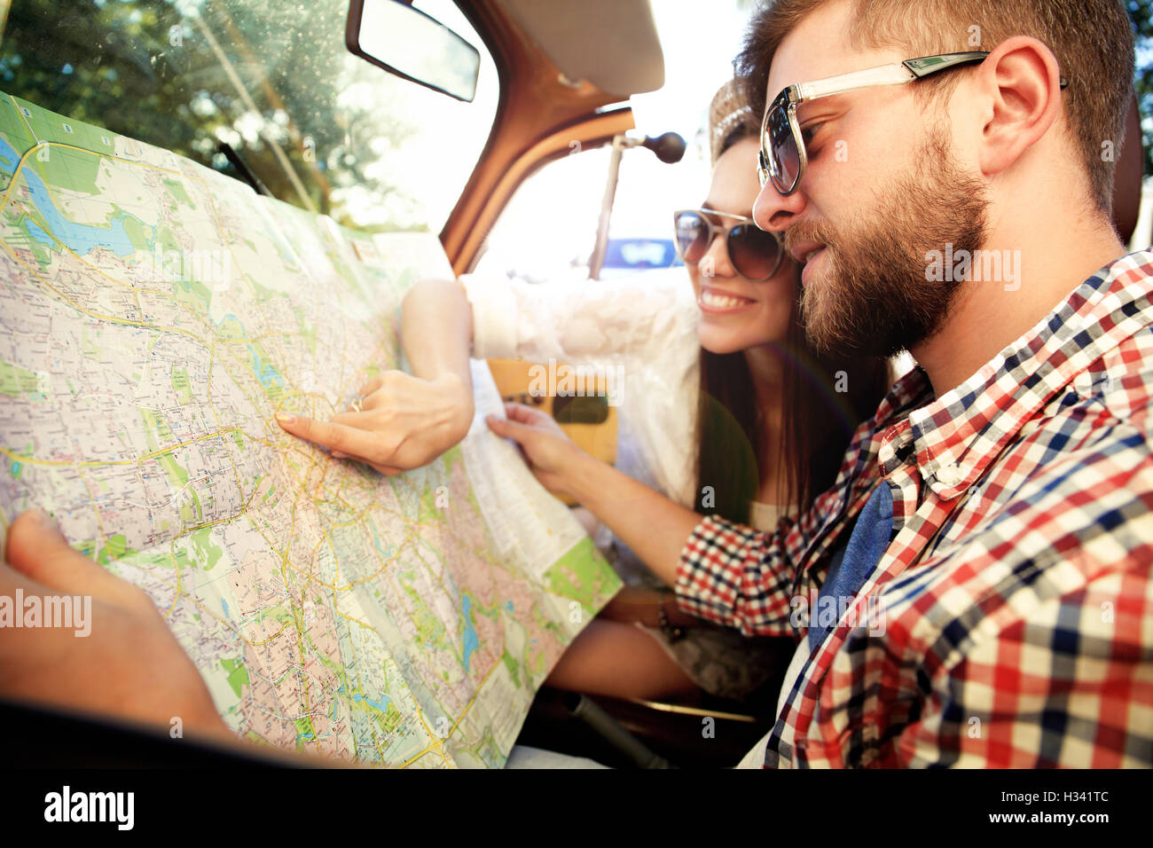 Young loving couple planning their romantic adventure - Stock Image