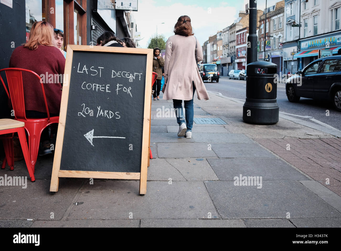 Last Decent Coffee For 20 Yards Sign On A Street Pavement In