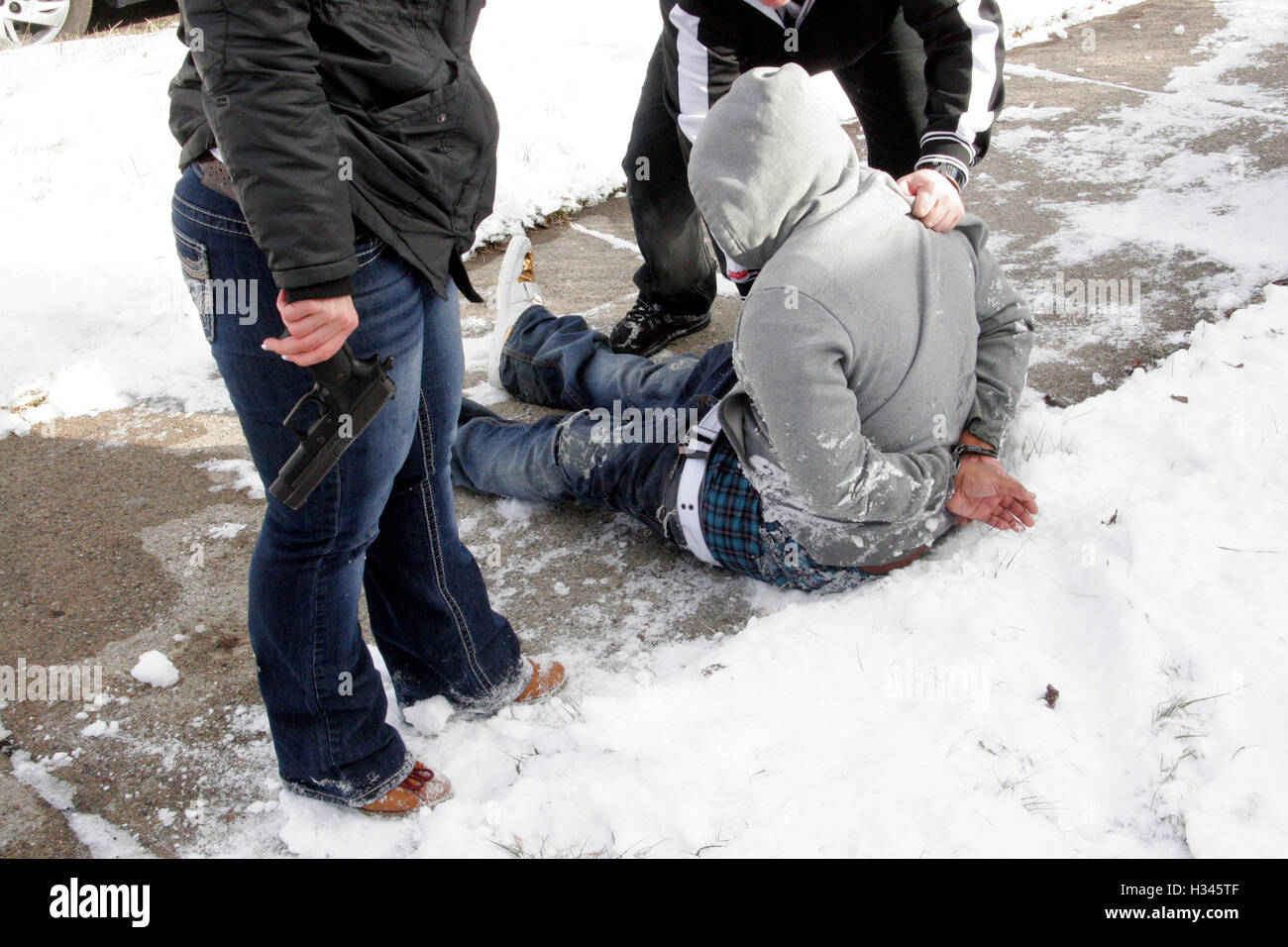 Detroit police detectives arrests a man found in possession of a handgun, Detroit, Michigan, USA - Stock Image