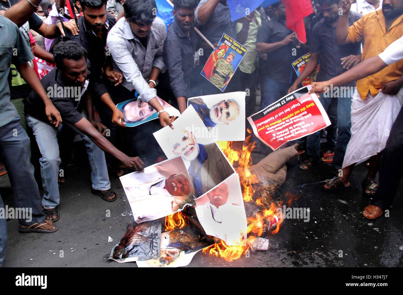 Supporters of several Tamil nationalist parties, burn effigies stage protest against the Kaveri water sharing issue - Stock Image
