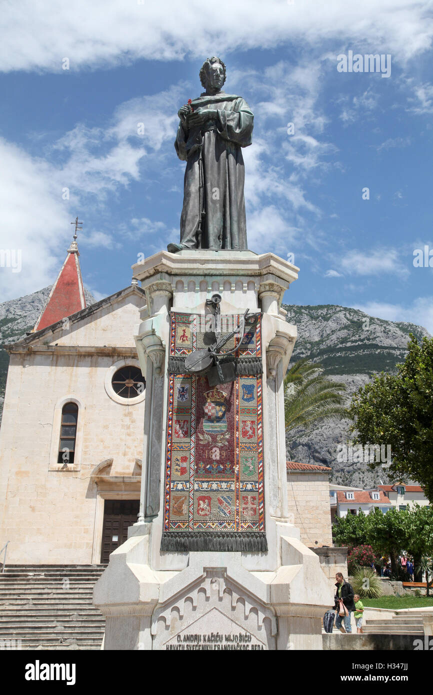 Statue of the 1700 century monk and poet Andrija Kacic in front of the church of St Marko - Stock Image