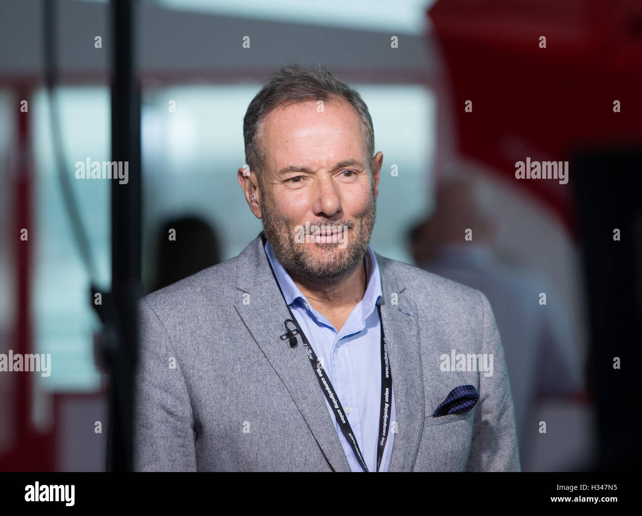 Derek Hatton being interviewed at the AAC Arena in Liverpool during the Labour party conference 2016 - Stock Image