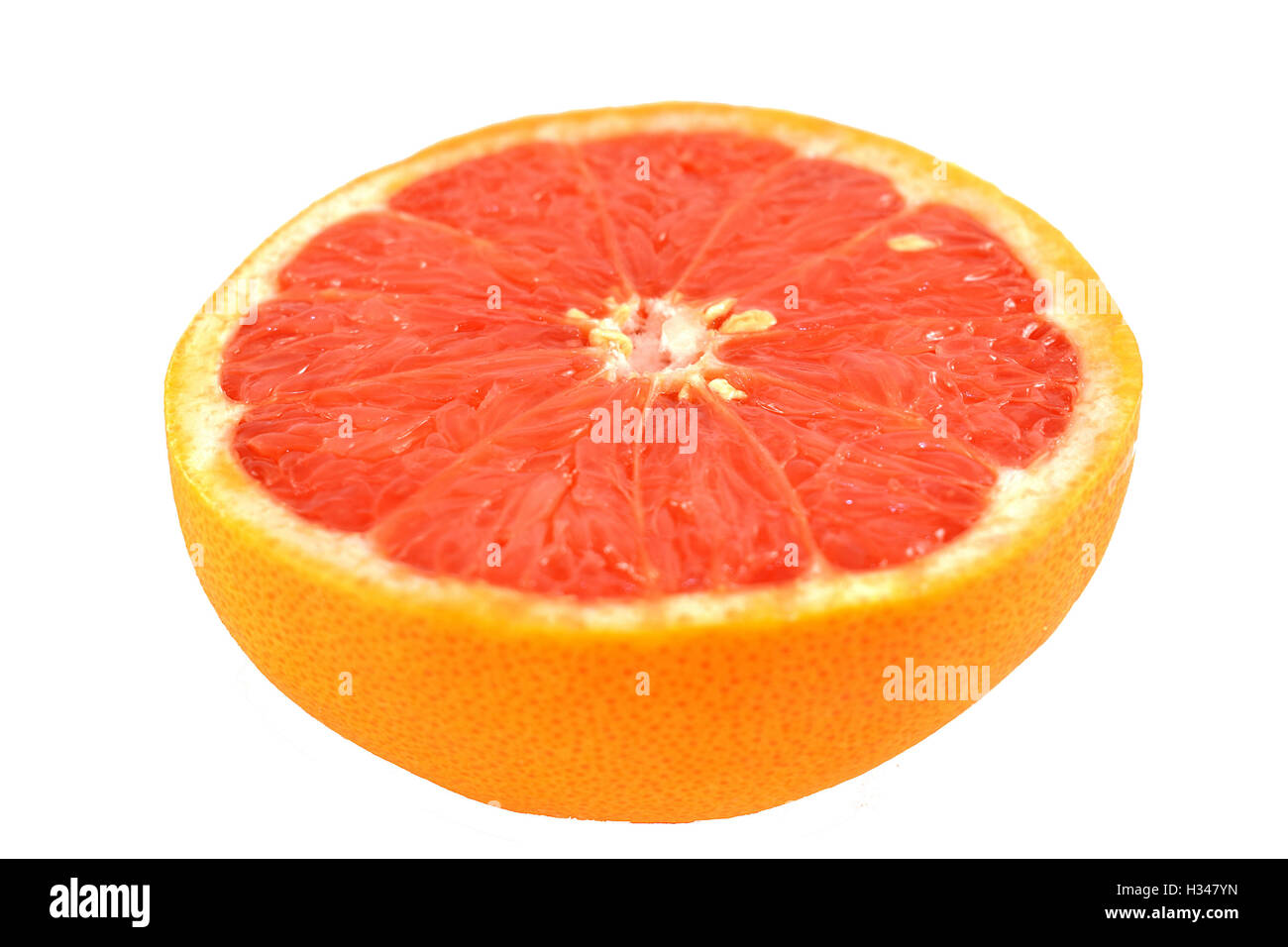 Half red grapefruit isolated on white background. - Stock Image