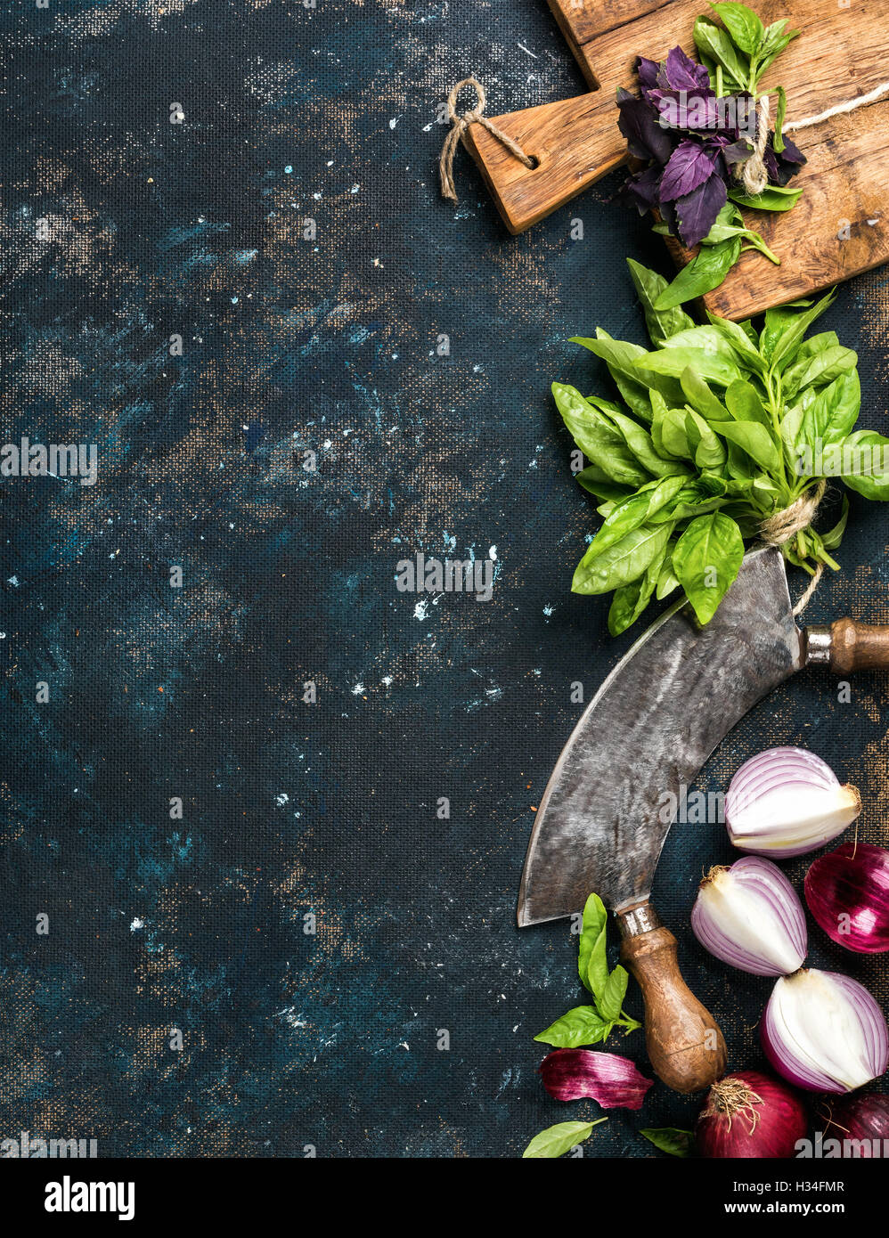 Healthy food cooking background over grunge dark blue plywood texture - Stock Image