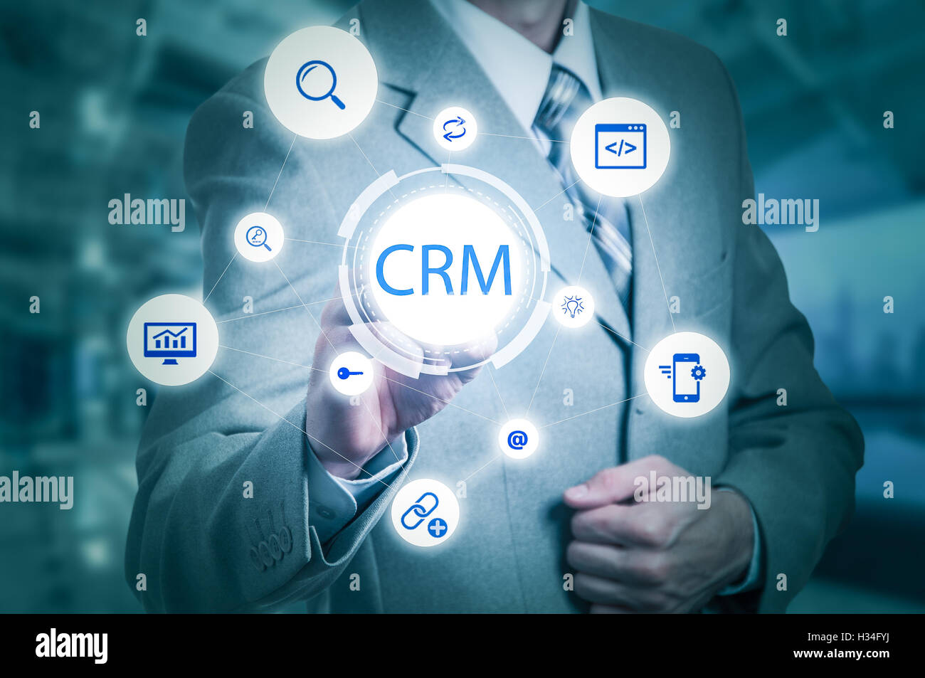 business, technology, internet and customer relationship management concept. Businessman pressing crm button on - Stock Image