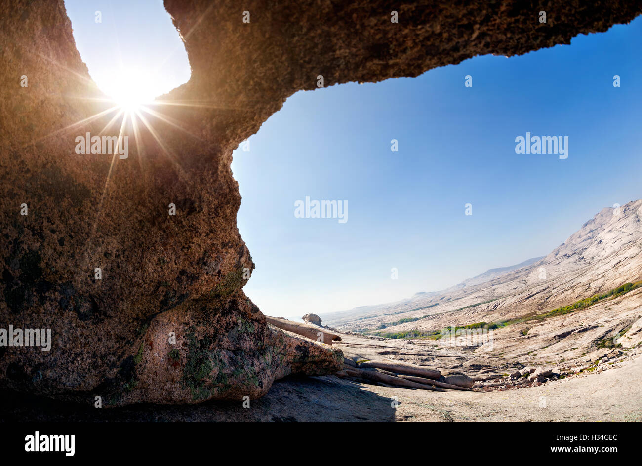 Cave in the Desert Mountains with sun at the hot day in eastern Kazakhstan - Stock Image