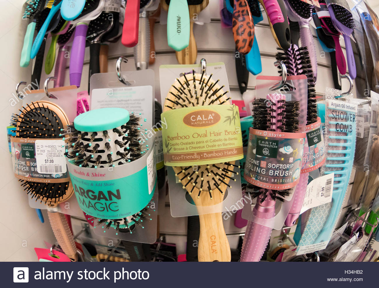 Hair Care Products On Display Stock Photos Ovale Olive Oil 100 Ml Diverse Brushes And Combs Arranged In A Store Image