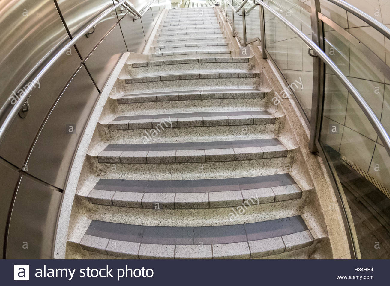 Distorted flight of stairs in a subway station - Stock Image