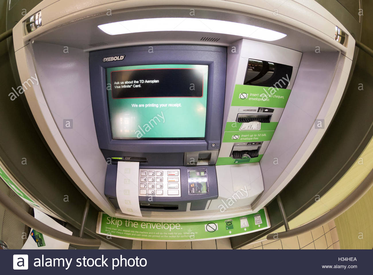 TD bank: Automated Teller Machine (ATM) printing out a slip