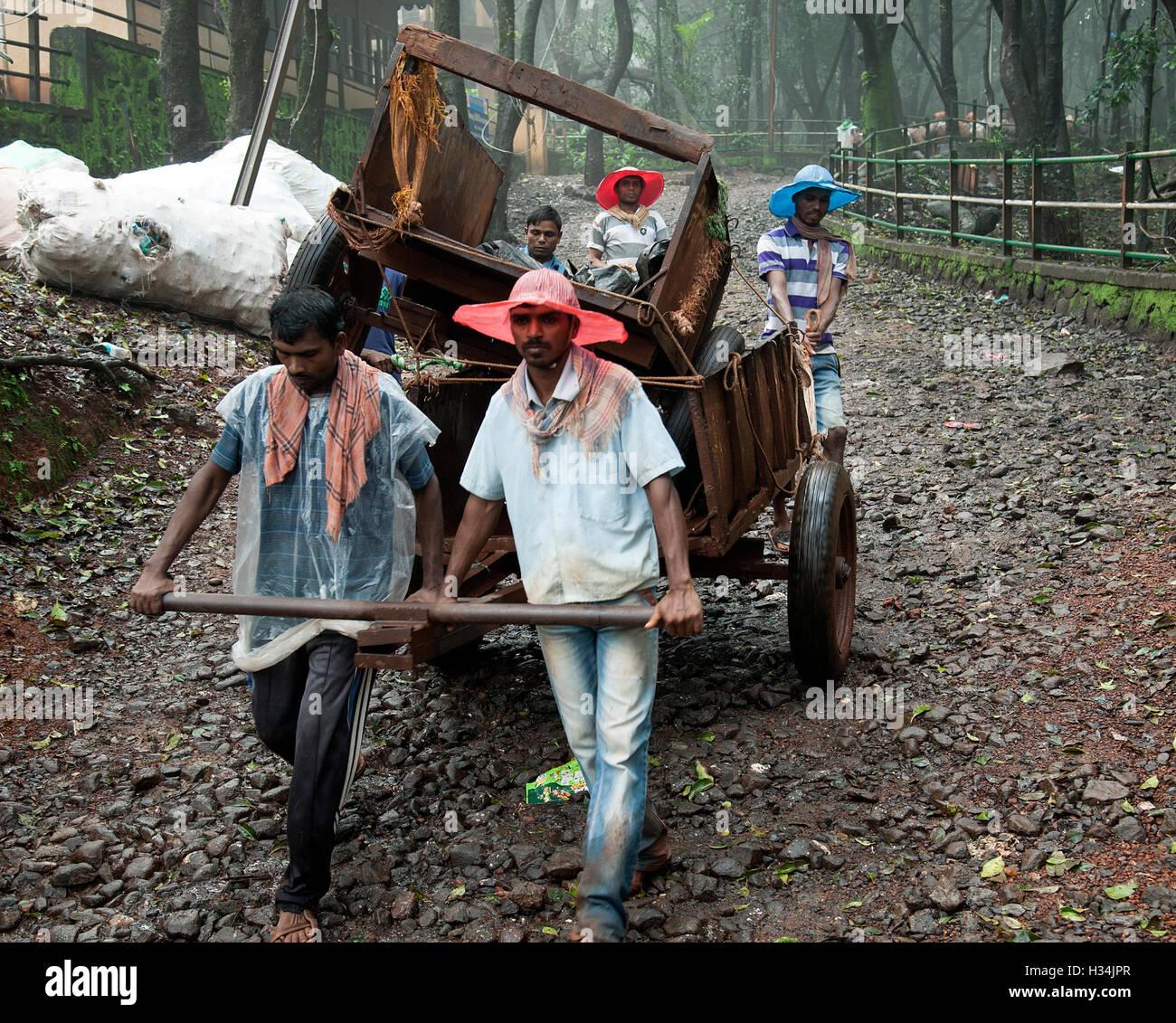The image of Cart puller with luggage in Matheran, Maharashtra, India - Stock Image