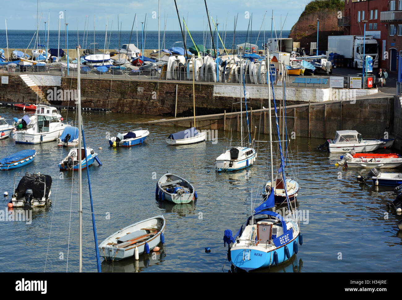 Paignton Harbour with the tide in and bathed in the Autumnal sunlight. - Stock Image