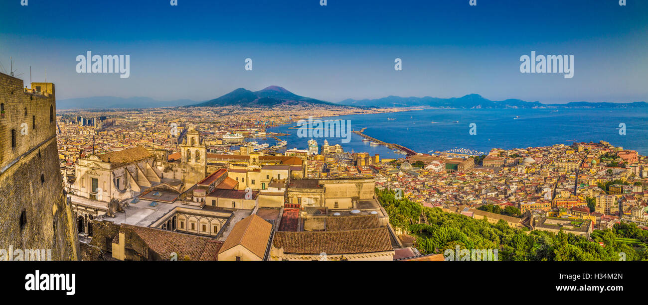 Panoramic view of the city of Naples with Mount Vesuvius in the background in golden evening light at sunset, Campania, - Stock Image