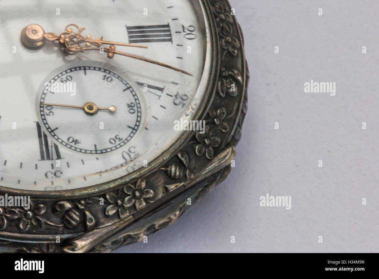 Old pocket watch from 1800 showing hour, minute, second hand. - Stock Image