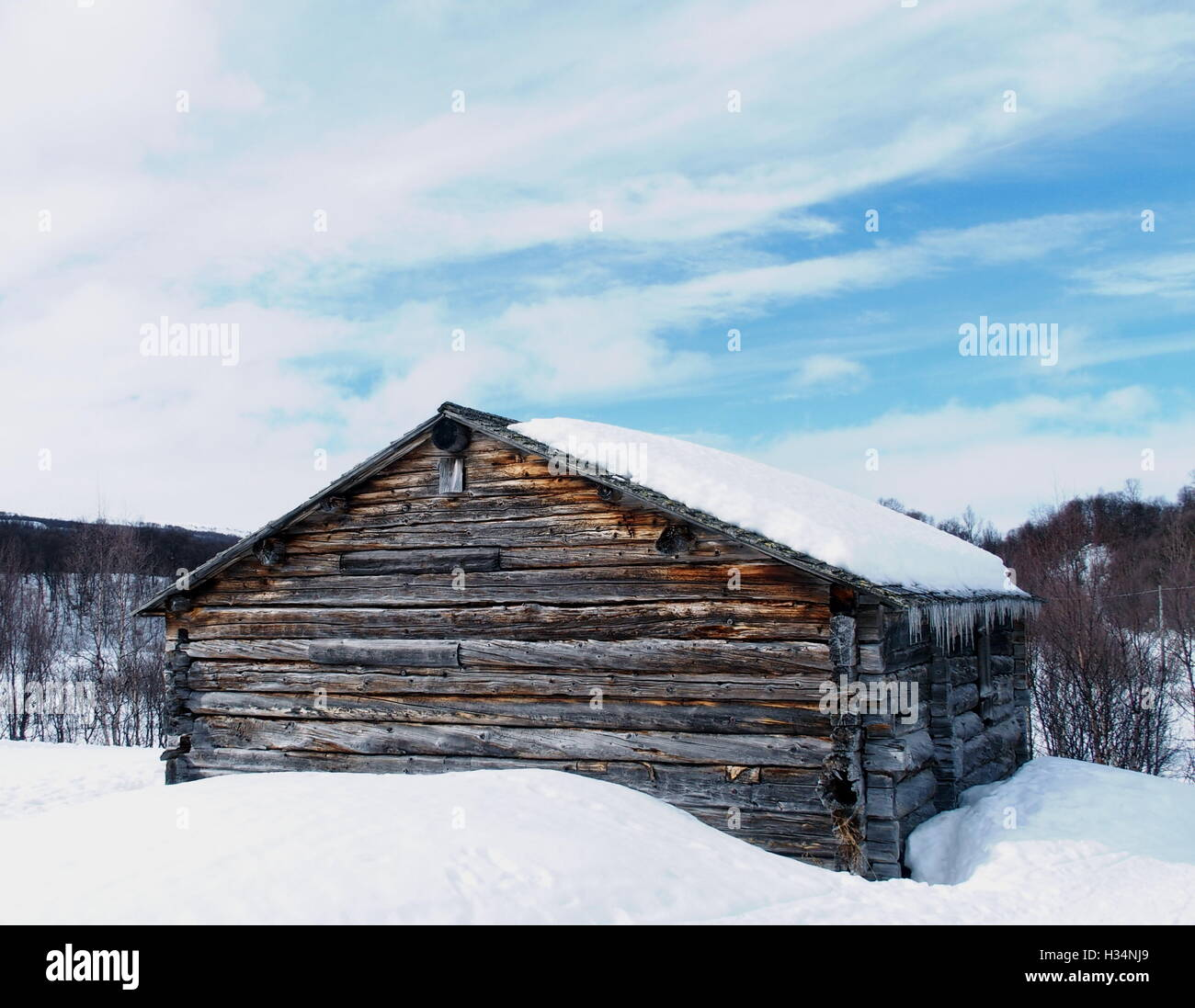 An old hay barn in Swedish mountains - Stock Image