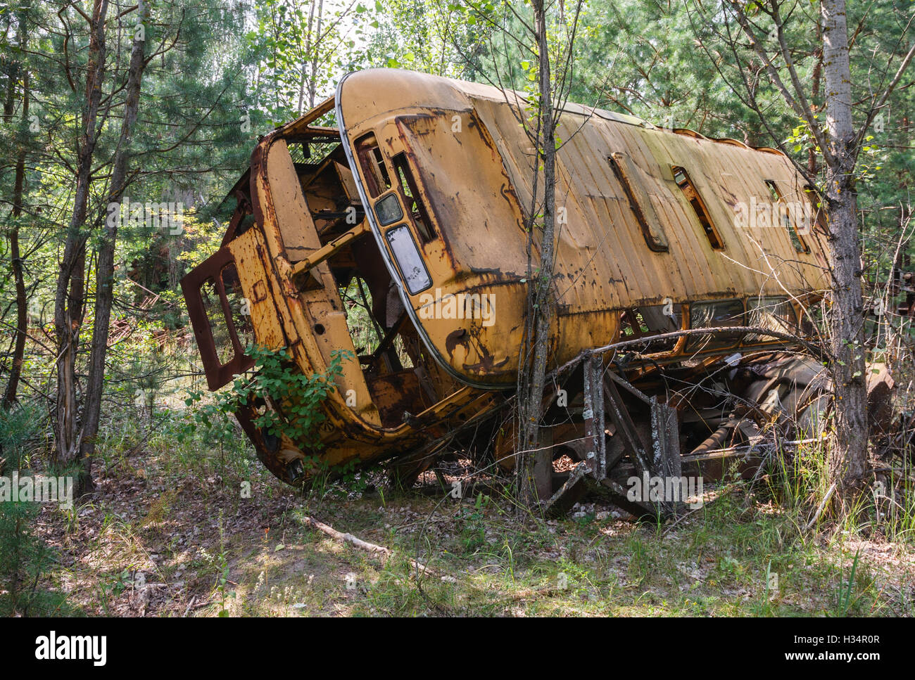 Old abandoned bus in the Chernobyl Exclusion Zone, Ukraine. - Stock Image