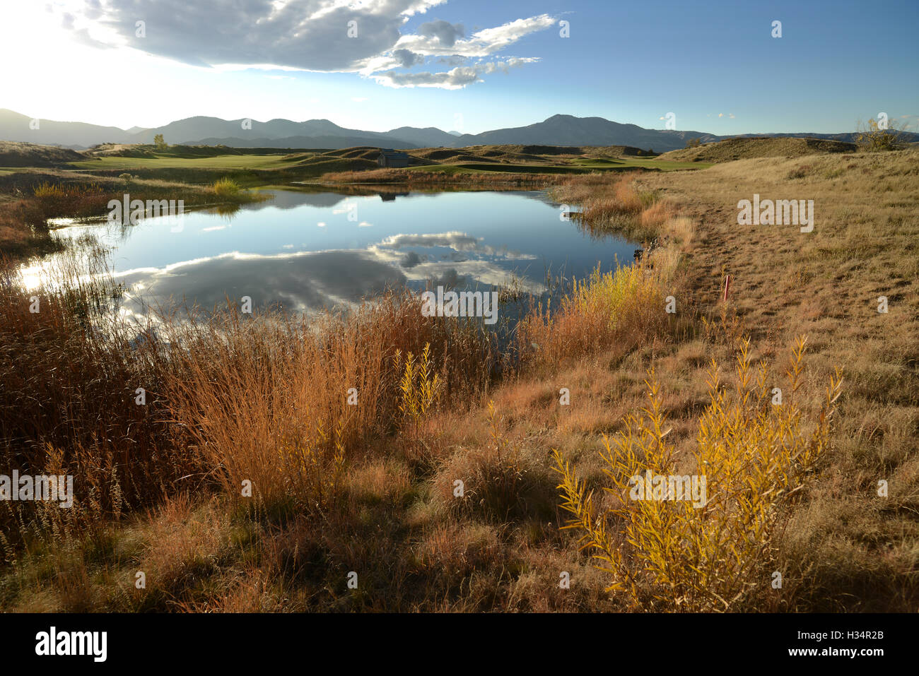 Autumn Mountain Pond - Sunset at a small pond in Bear Creek Trail Park, Denver - Lakewood, Colorado. USA. - Stock Image