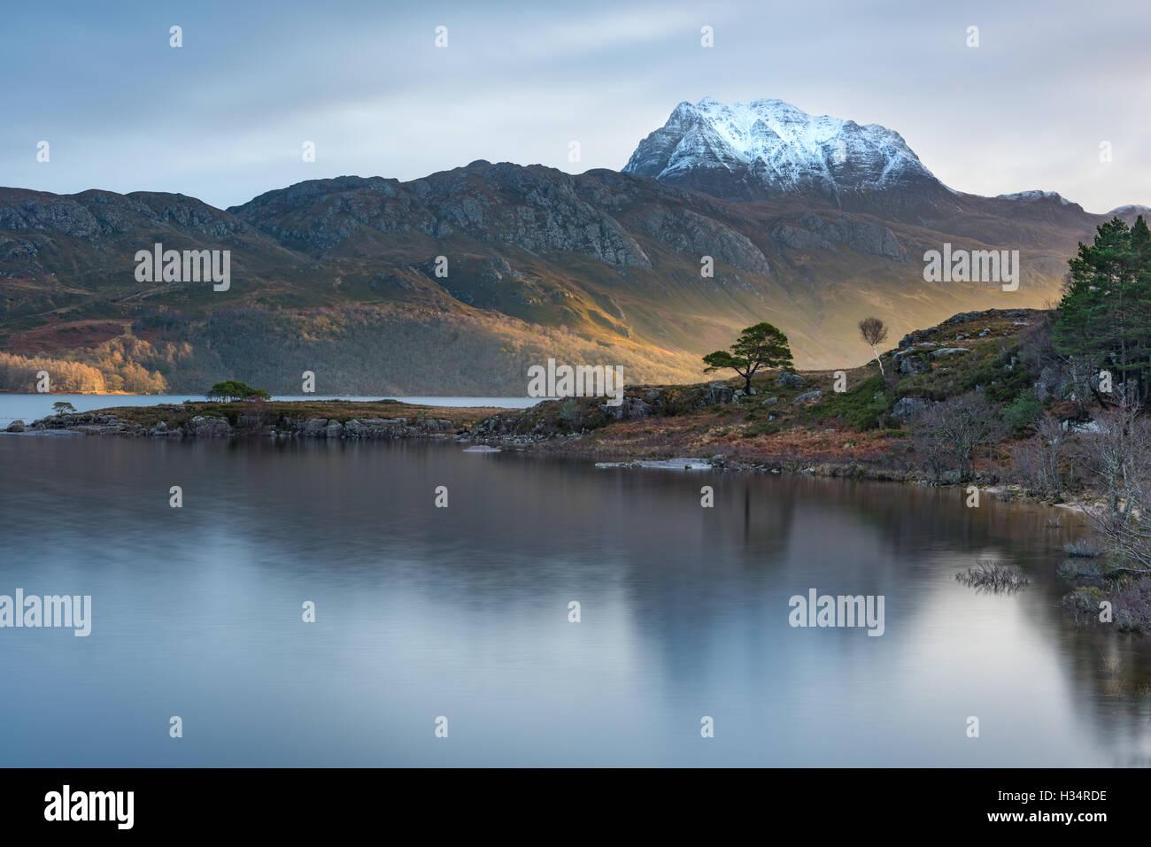 Burst of sunlight over Slioch and Loch Maree, Scottish Highlands, Scotland - Stock Image