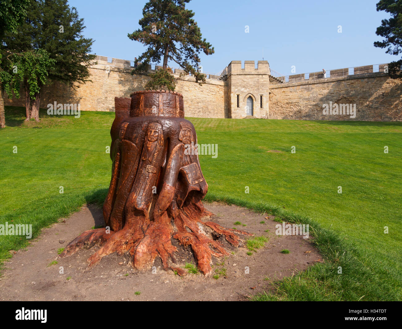 Carved tree stump in the grounds of Lincoln Castle - Stock Image