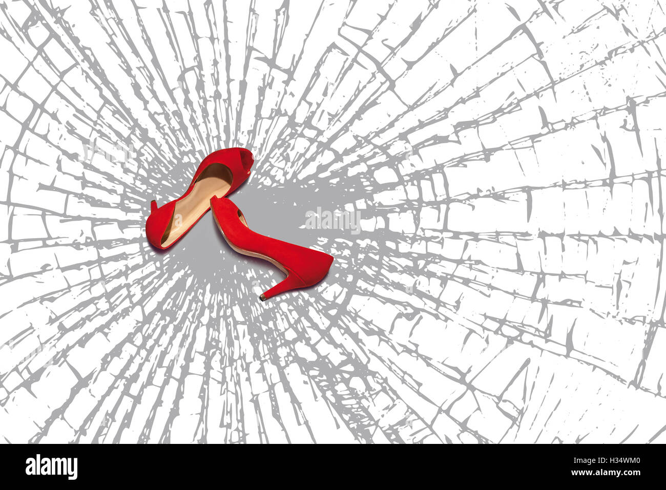 The design features two red women's shoes, are based on a full floor of broken glass fragments. - Stock Image