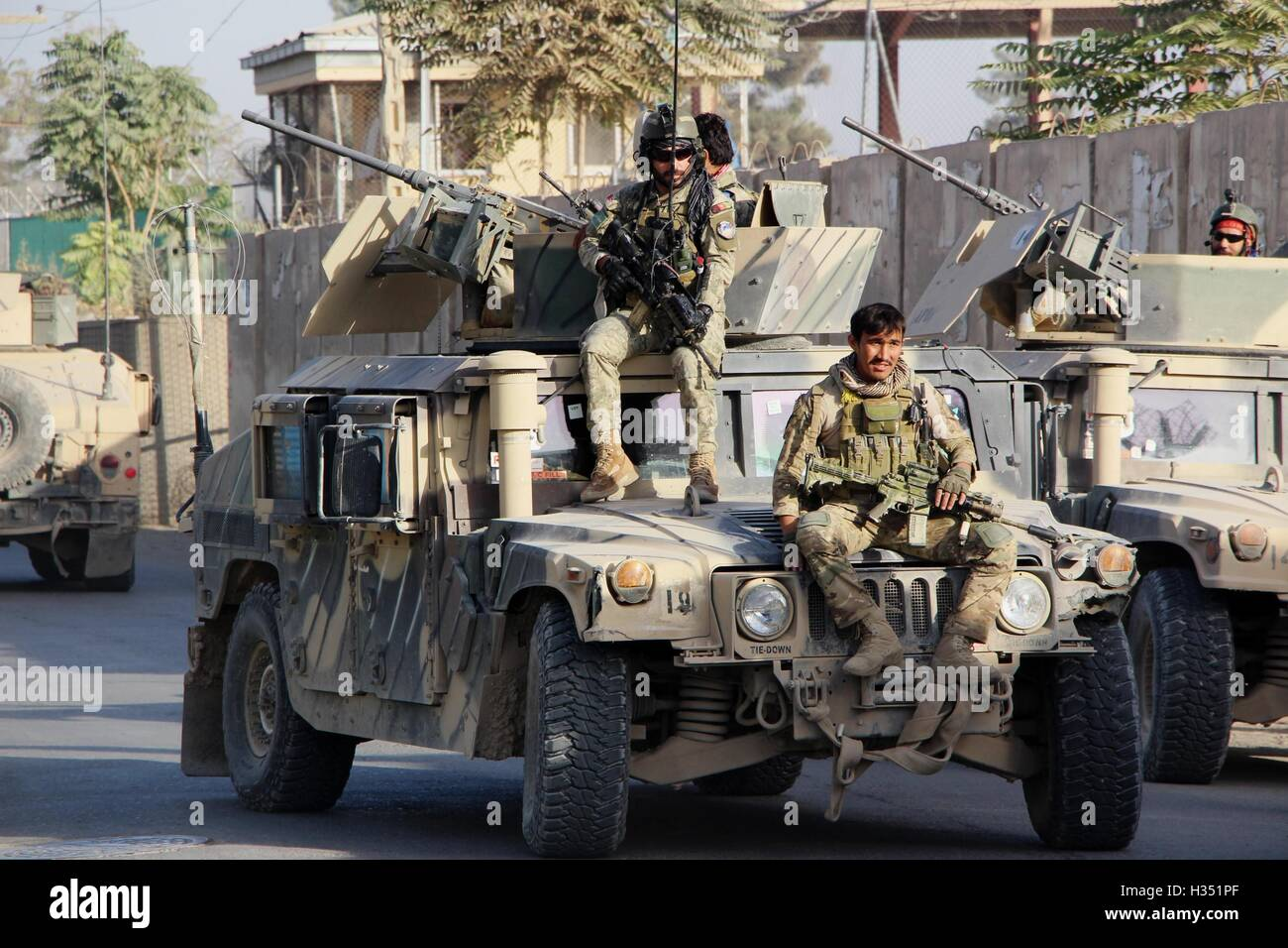 Kunduz, Afghanistan. 4th Oct, 2016. Afghan security force members take part in a military operation against Taliban - Stock Image