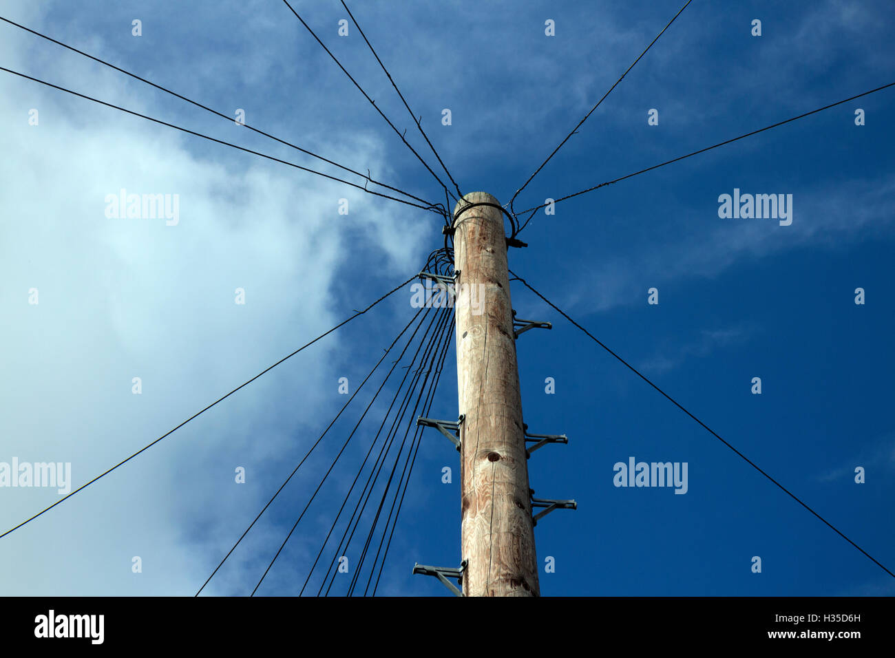 A telegraph pole with wires, UK - Stock Image