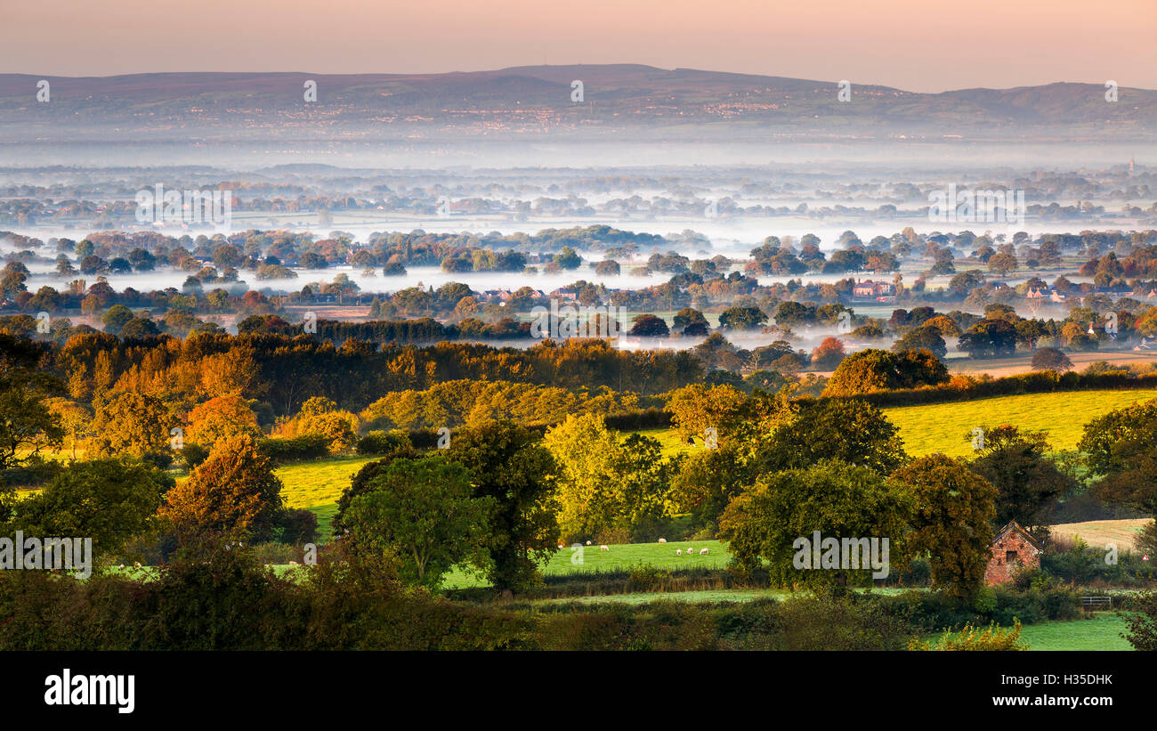 Autumn mists on the Cheshire plain extending across the landscape to the Welsh hills, Cheshire, England, UK - Stock Image