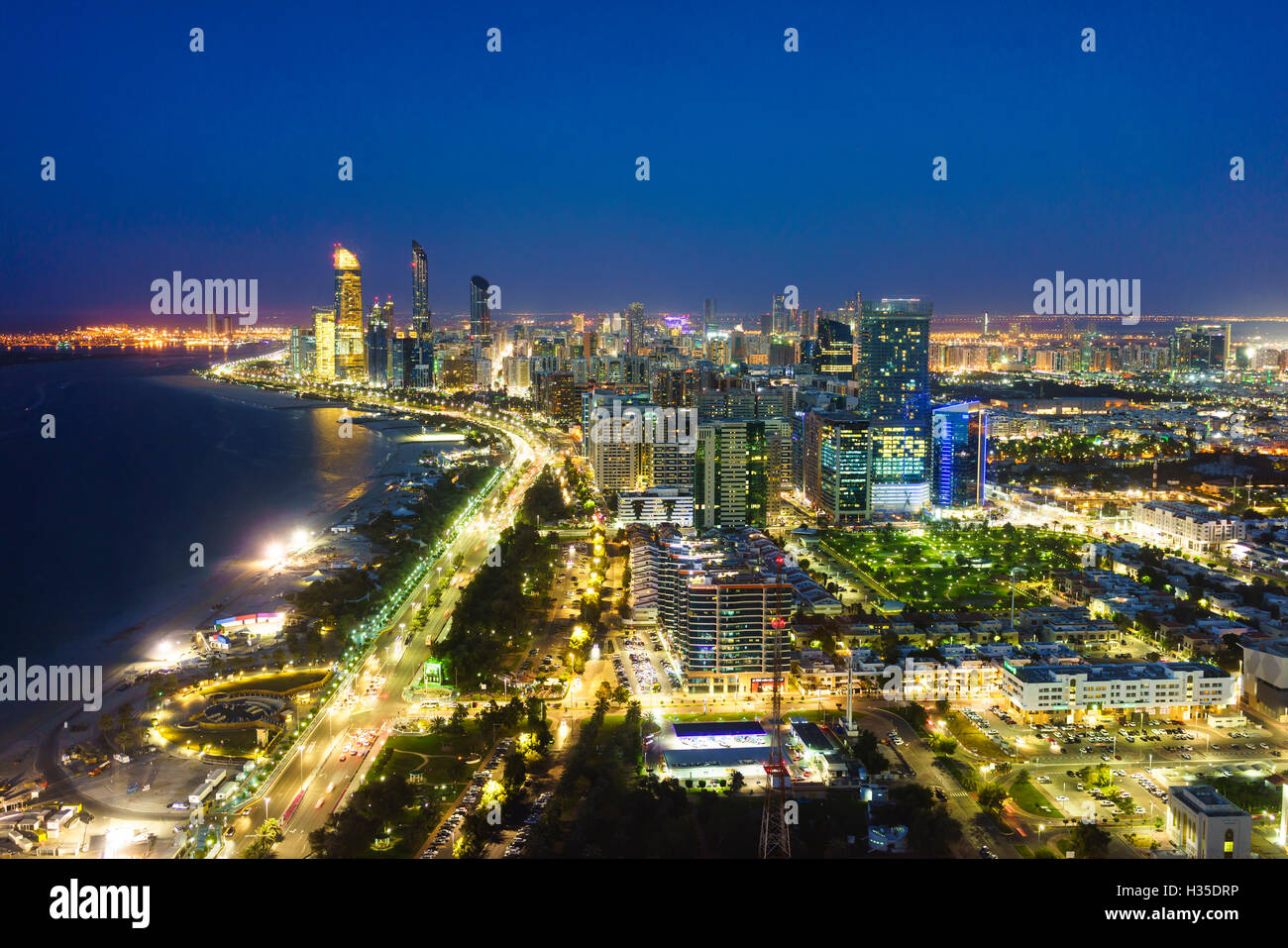 Skyline and Corniche, Al Markaziyah district by night, Abu Dhabi, United Arab Emirates, Middle East - Stock Image