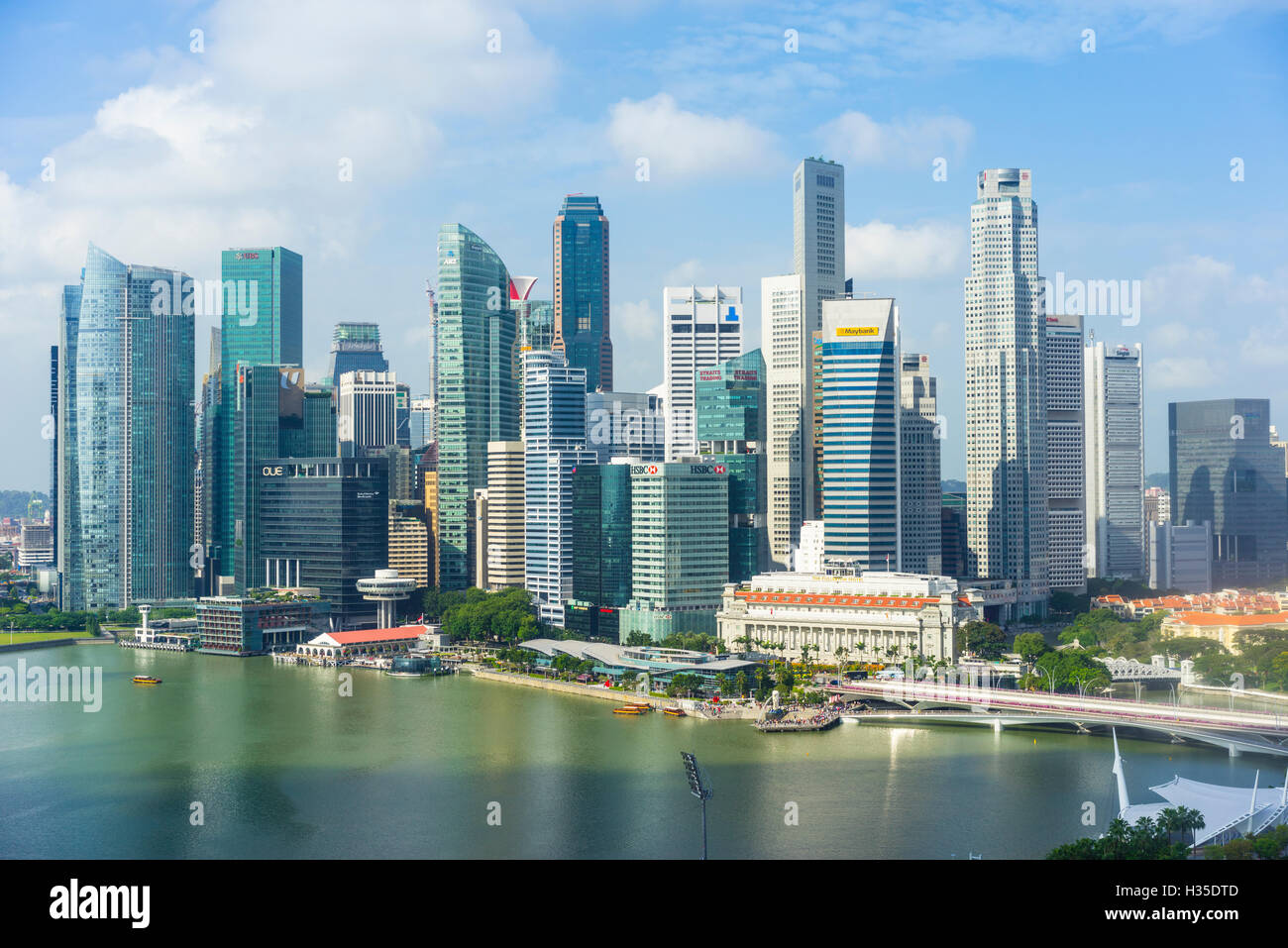 Singapore skyline, skyscrapers with the Fullerton Hotel and Jubilee Bridge in the foreground by Marina Bay, Singapore - Stock Image