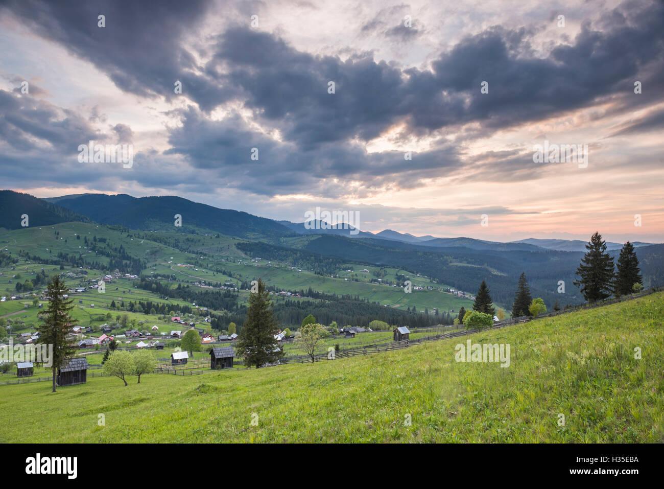 Bukovina Region (Bucovina) landscape at sunset, Paltinu, Romania - Stock Image
