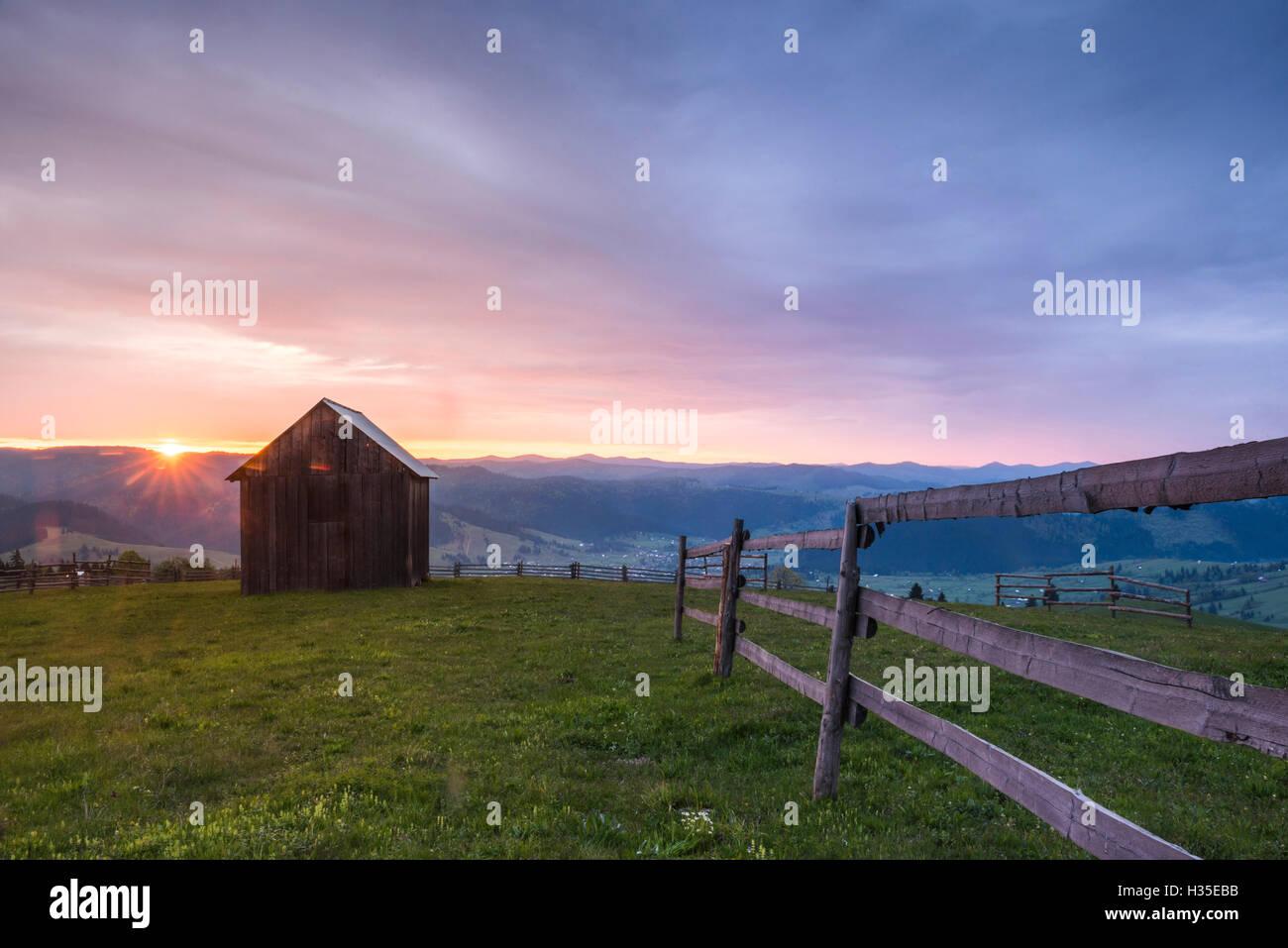 Bukovina Region (Bucovina) landscape at sunrise, Paltinu, Romania - Stock Image
