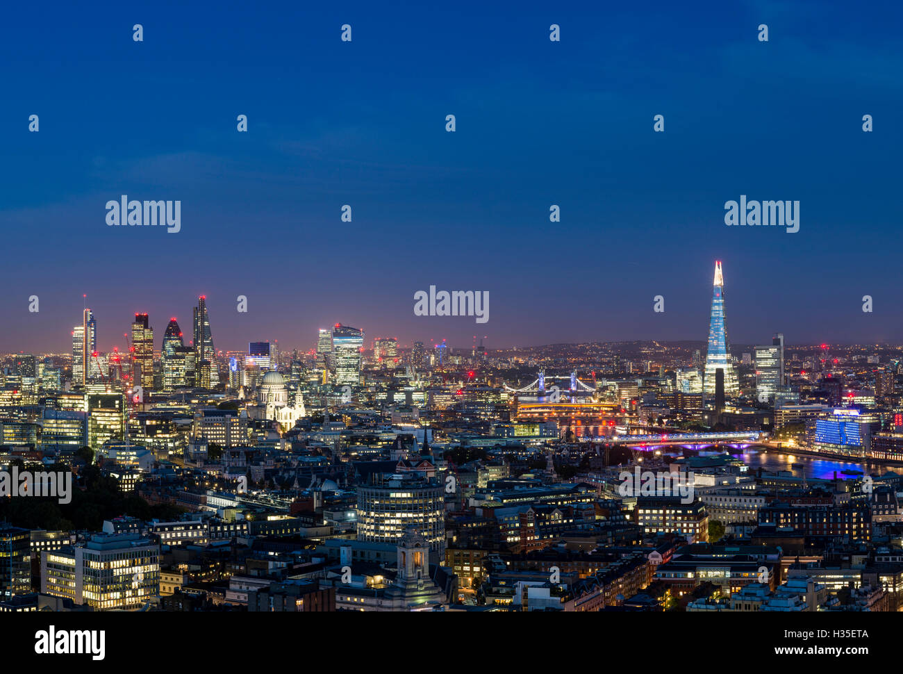 A view of London and the River Thames from the top of Centre Point tower across to The Shard, St. Paul's Cathedral, - Stock Image