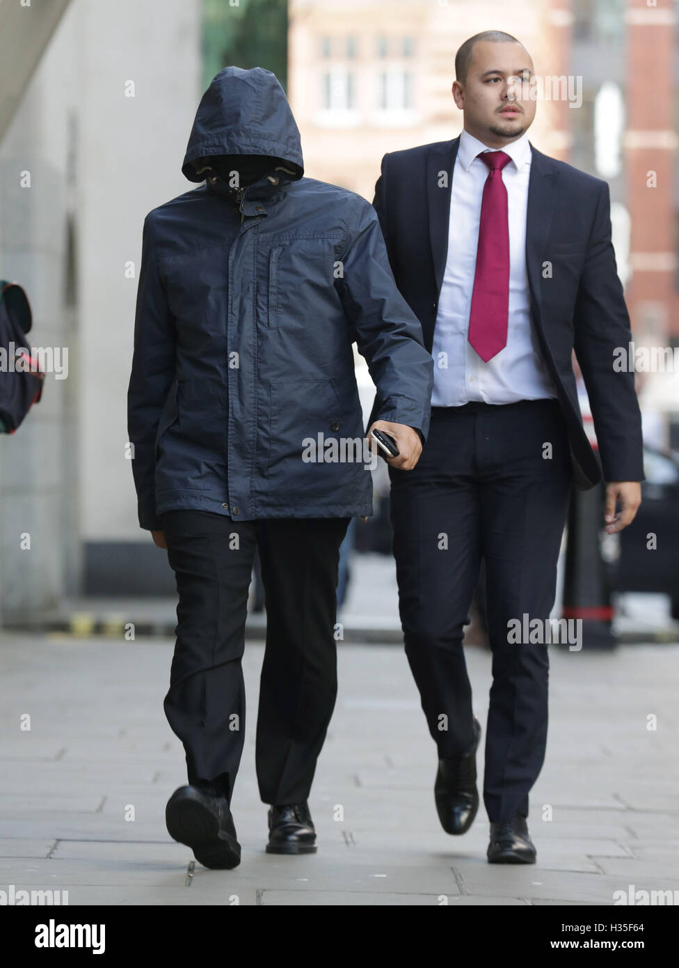 """Undercover journalist Mazher Mahmood (left), who was known as the """"Fake Sheikh"""", arrives at the - Stock Image"""