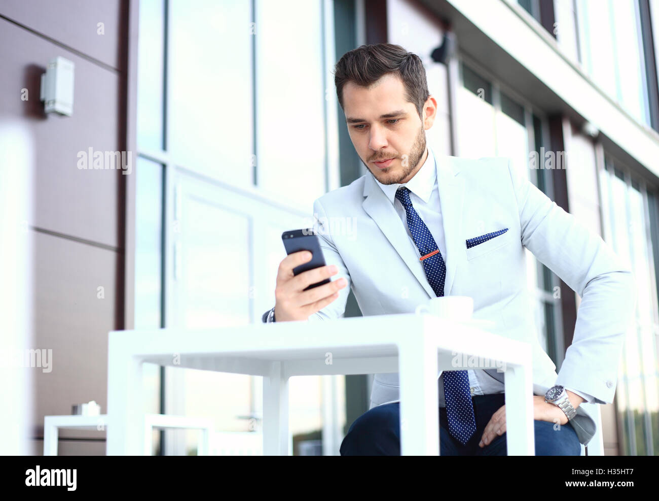 Man on smartphone - young business man talking on smart phone. Casual urban  professional businessman
