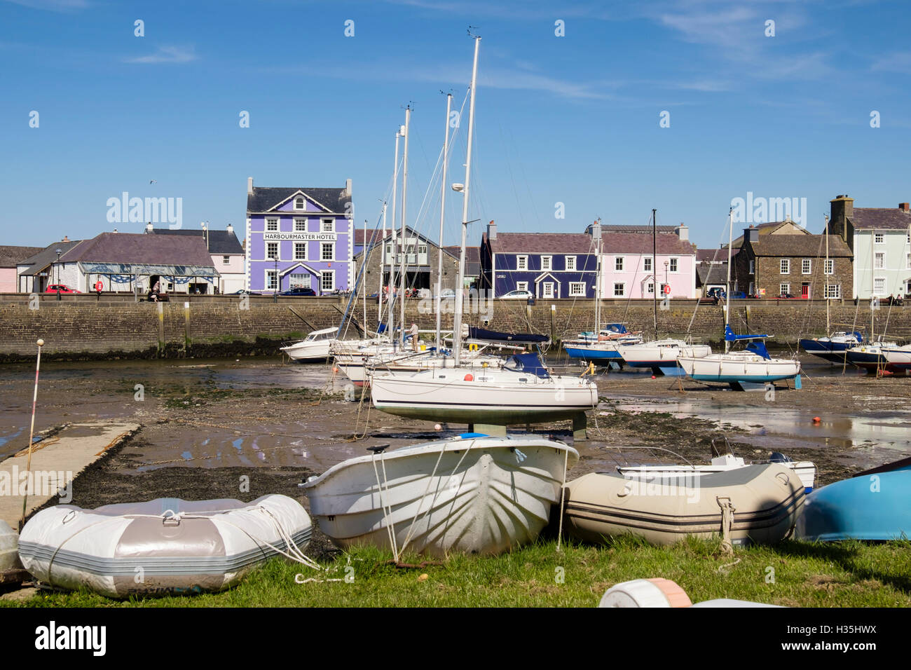 Regency style houses overlooking boats moored in the harbour on Afon Aeron River. Aberaeron, Ceredigion, Wales, - Stock Image