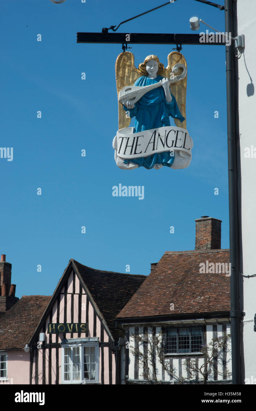 Pub sign over 15th century buildings in the town of Lavenham, once one of the wealthiest in England, Suffolk. Stock Photo