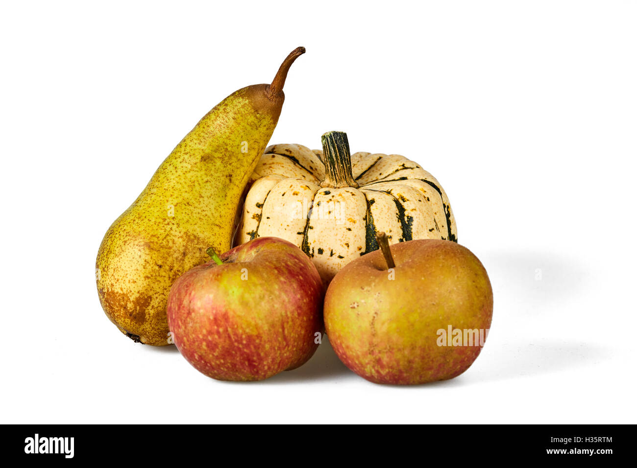 Isolated apple, pear and pumpkin autumn seasonal fruits - Stock Image