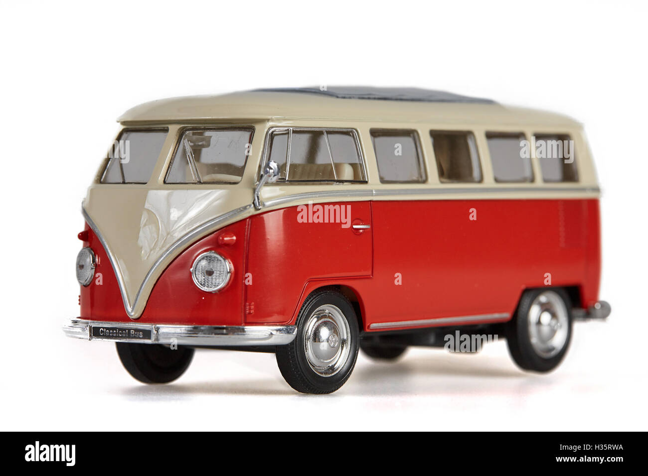Isolated red vw bus van on white background - Stock Image