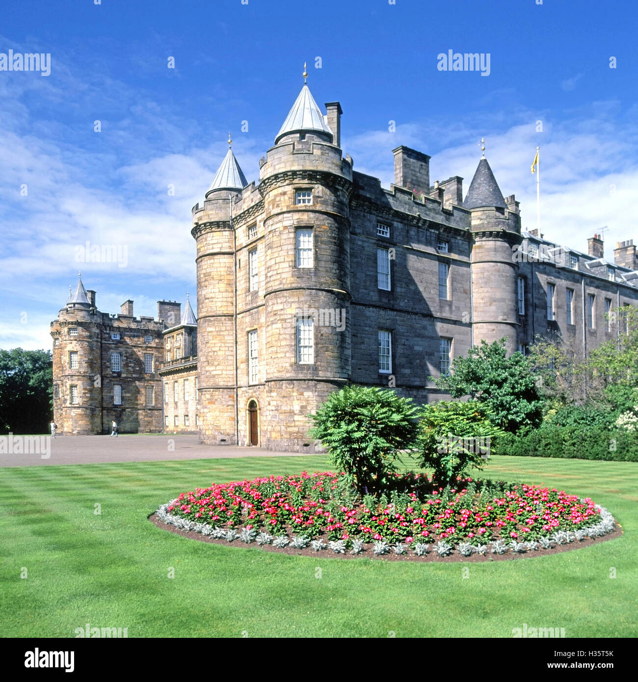 Flowers and lawn stripes at front of Scottish Holyrood Palace in Edinburgh UK official residence of the British - Stock Image