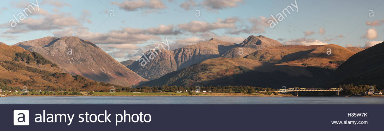 Mountain panoramic view from Loch Linnhe looking over to North Ballachulish and the Ballachulish bridge. Stock Photo