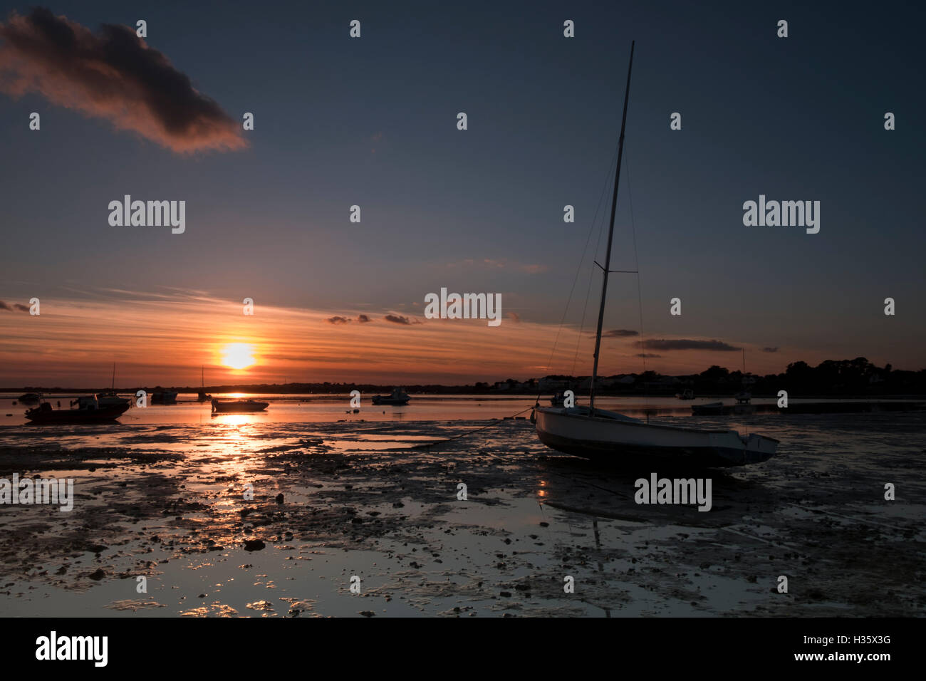 Glorious sunset over Christchurch Harbour from Mudeford Dorset - Stock Image