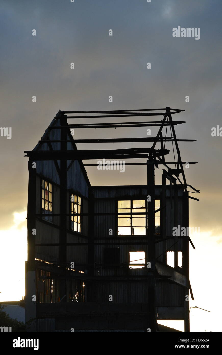 Silhouette of partially Demolished factory building on Grimsby docks - Stock Image