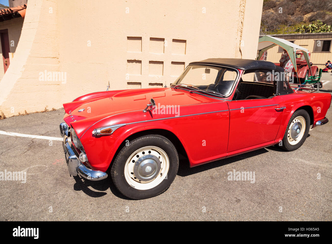 Laguna Beach Ca Usa October 2 2016 Red 1967 Triumph Tr4a Stock 1941 Ford Opera Coupe Displayed At The Rotary Club Of Classic Car Sho