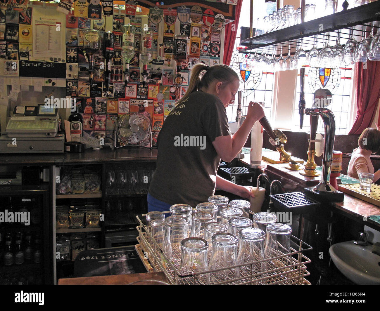 Pulling a handpull pint in a Yorkshire pub,with empty glasses, England, UK Stock Photo
