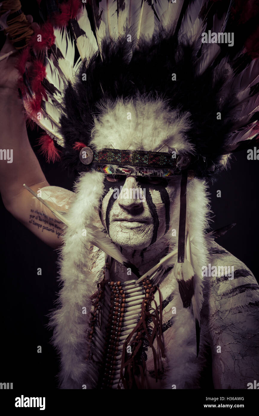 American Indian chief with big feather headdress Stock Photo