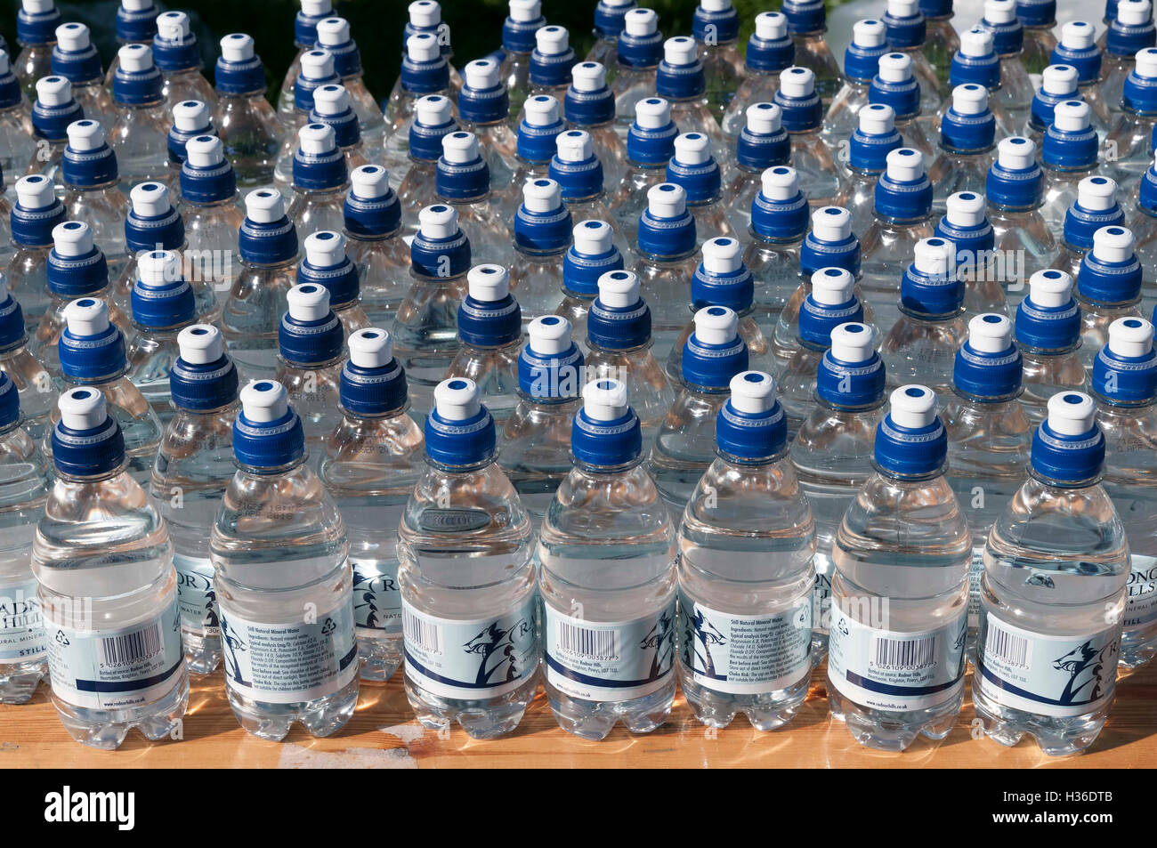 Water bottles. Mineral Sports tops - Stock Image