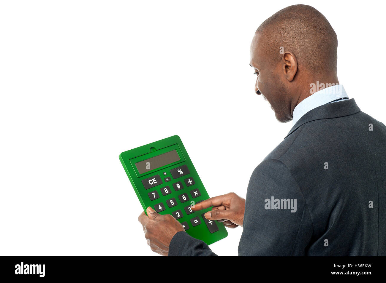 Rear view of businessman using calculator - Stock Image
