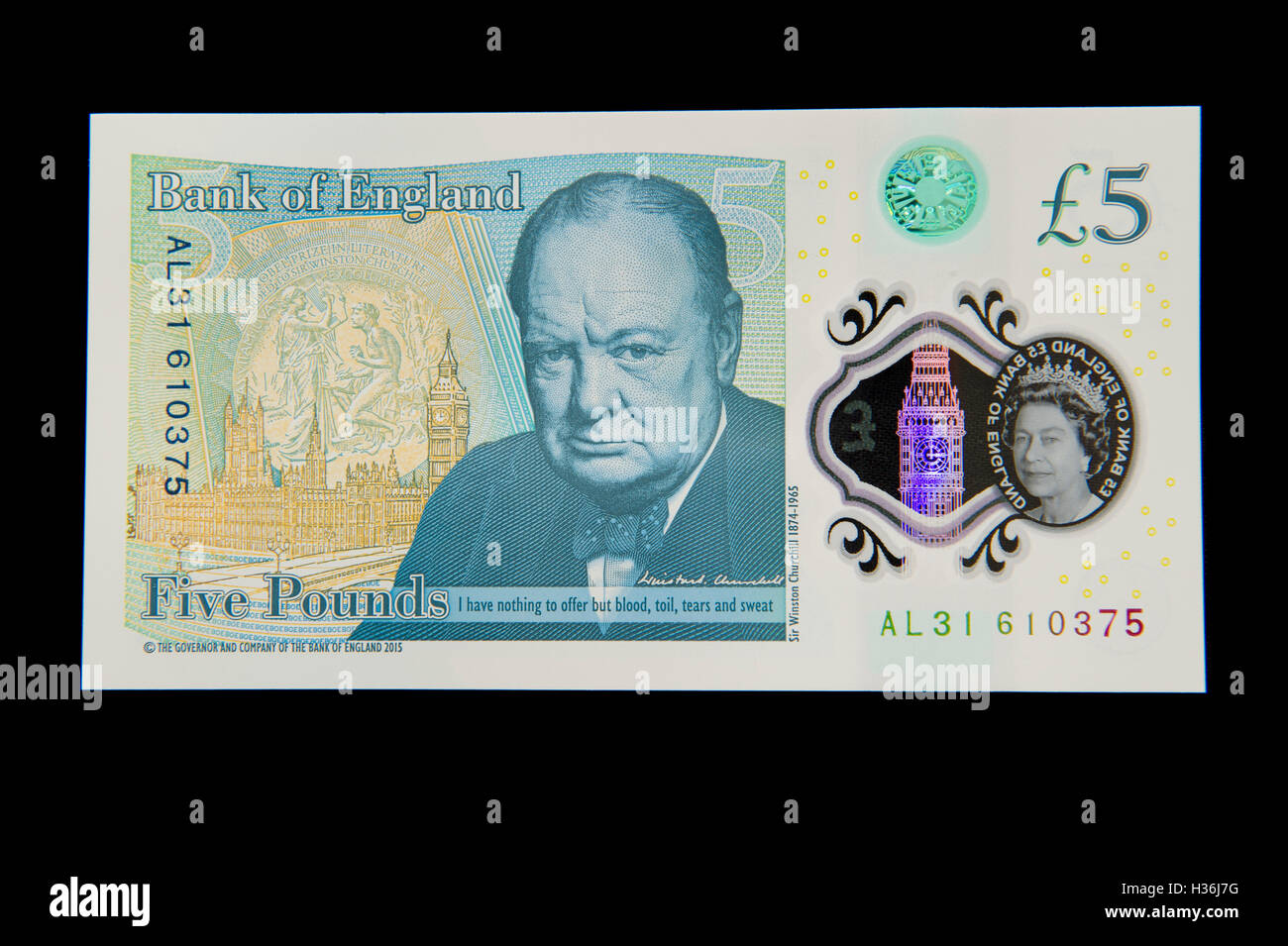 Back view of the new plastic (polymer) five pound note on a black background - Stock Image